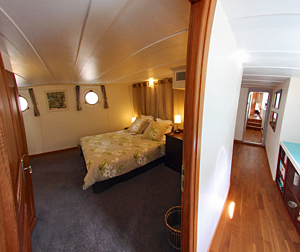 Spacious cabins with choice of twin beds or queen beds